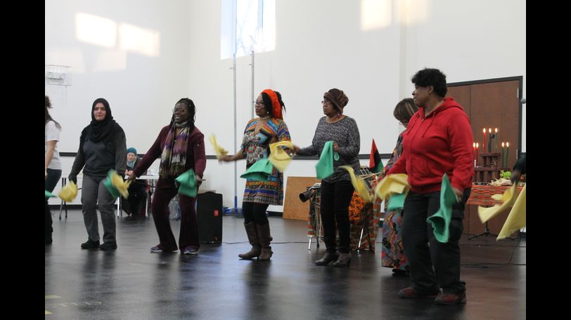 Residents get involved in the presentation and learn some traditional African dances associated with Kwanzaa