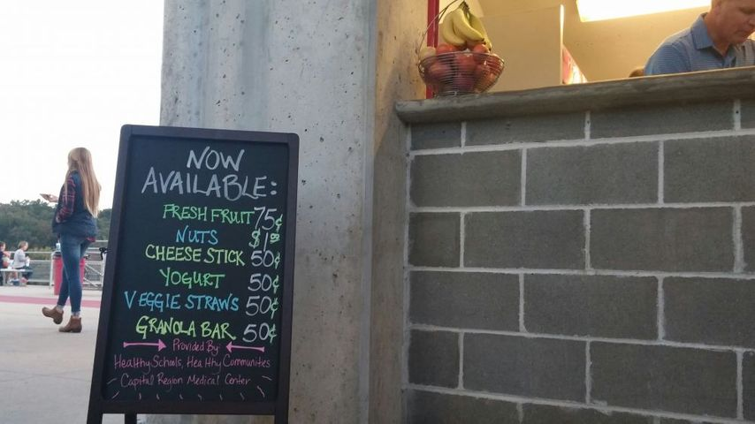 A display lists prices of the new healthy snacks offered at high school football games in Jefferson City.