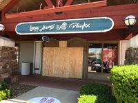 Driver loses control, car goes through outlet clothing store
