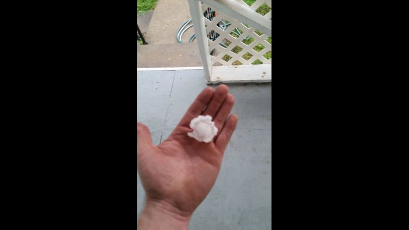 Eli Kane Kramer holds a piece of hail outside in Mexico.