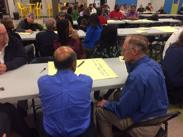 Attendees split into groups and write suggestions regarding what the school can do to better address diversity issues.