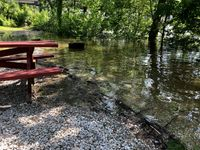 Flooding causes evacuation at camp site