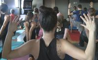 Yoga lovers reach for river relief at charity session