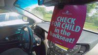 Backseat reminder hang tags help prevent hot car deaths