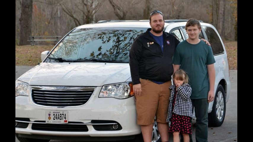 Steven Hughes stands in front of his minivan with his children at Roubidoux Park in Waynesville, Mo. on Tuesday, Nov. 29, 2016. He purchased this vehicle after having to return a previous vehicle back to the dealership because he did not receive a title.