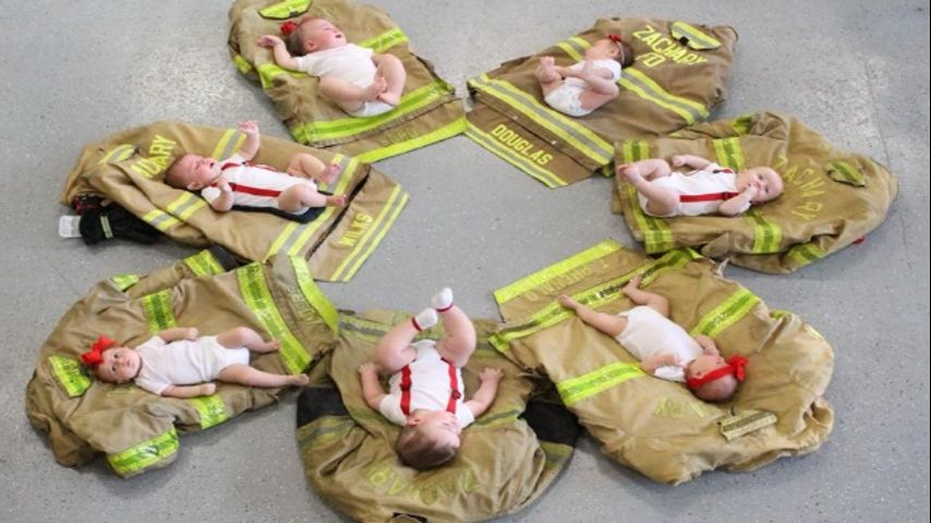 local fire department shares adorable baby boom pictures to congratulate new firefighting parents