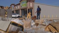 Business owner fed up with trash pile in local shopping center