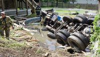 Crash leaves septic truck upside-down in backyard pool