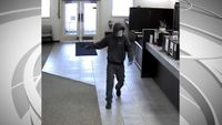 Columbia police release surveillance photos from armed robbery at bank