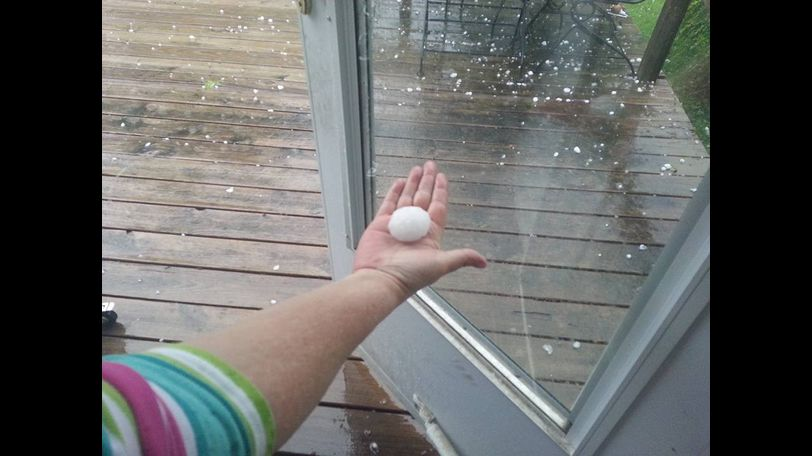Gina Beacom Davee holds hail outside in Mexico.