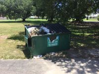 Property owner says garbage company won't pick up dumpster full of trash