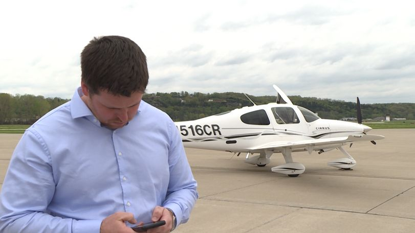 State Treasurer Scott Fitzpatrick files a flight plan on his iPhone before departing the Jefferson City Municipal Airport.