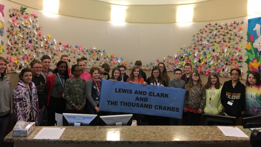 Lewis and Clark Middle Schoolers' pose for a picture after signing the banner.