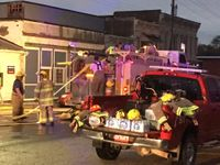 Story image: Fire badly damages auto shop in downtown Huntsville