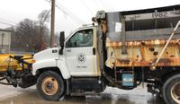Story image: Columbia Public Works plow drivers treating roads around the clock