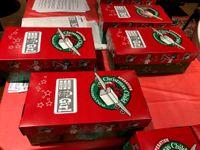 Story image: Columbia volunteers make Christmas gifts possible for kids overseas