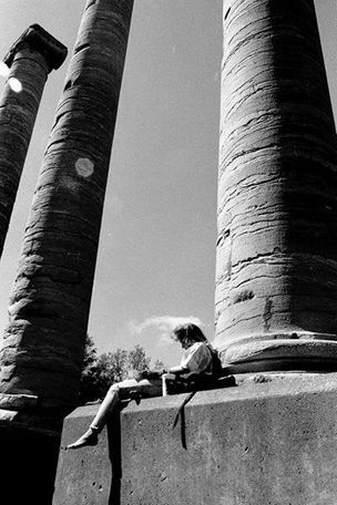 Student studying by The Columns