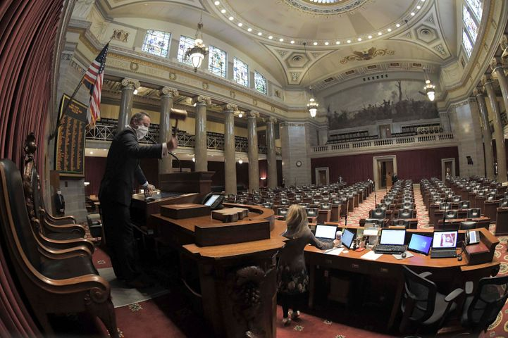Missouri House Speaker Elijah Haahr, R-Springfield, lowers the gavel in a nearly empty chamber at the opening of today's legislative session. (Courtesy: Tim Bommel)