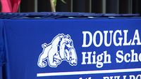 Story image: Douglass High School graduates walk the stage Friday morning