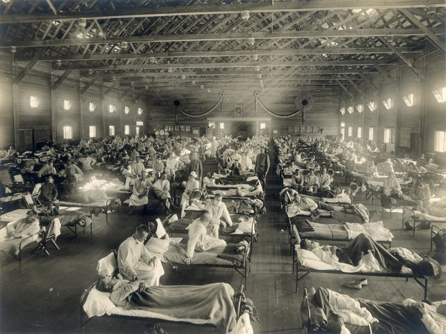 Beds with patients in an emergency hospital in Camp Funston, Kansas, in the midst of the influenza epidemic.