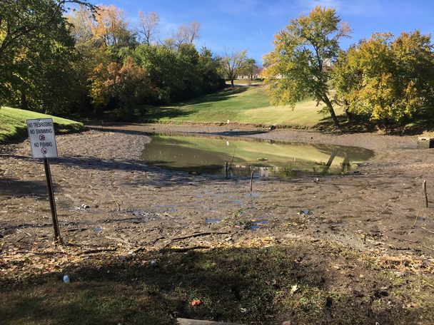 A drained a pond is seen as part of the search effort for missing 4-year-old Darnell Gray on Monday, Oct. 29, 2018, in Jefferson City, Missouri.