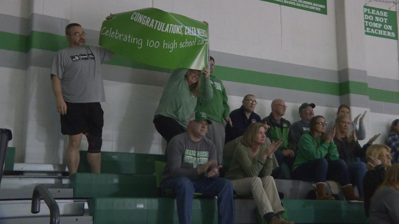 Meeks' parents celebrated their son's milestone win with a sign in the stands.