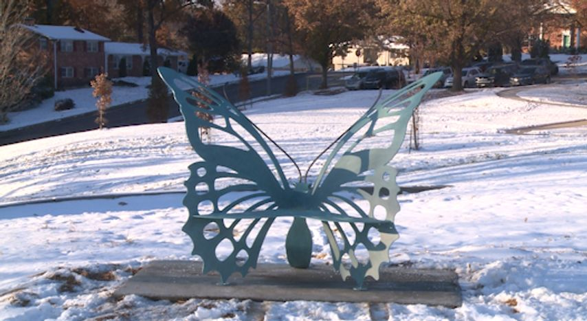 The butterfly shaped bench dedicated to the late Mayor Darwin Hindman is placed right next to the playground at Russell Boulevard Elementary. It's available for anyone to sit on, and has Hindman's name on a gold plaque in the center.