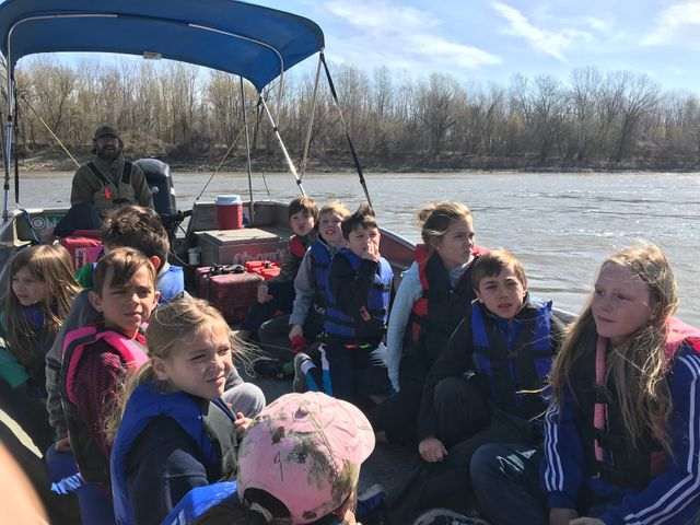 4th grade students on a boat ride on the Missouri River.