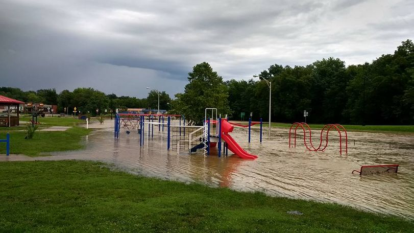 The playground at Memorial Park in Fulton, Missouri was covered in deep water on August 2, 2016. Photo/Michael Rogers