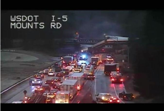 An Amtrak train car derailed and is dangling on to Interstate 5 in Pierce County, Washington, according to the Washington State Department of Transportation's twitter. All southbound lanes of the I-5 are closed due to the derailment. Credit: Washington Department of Transportation