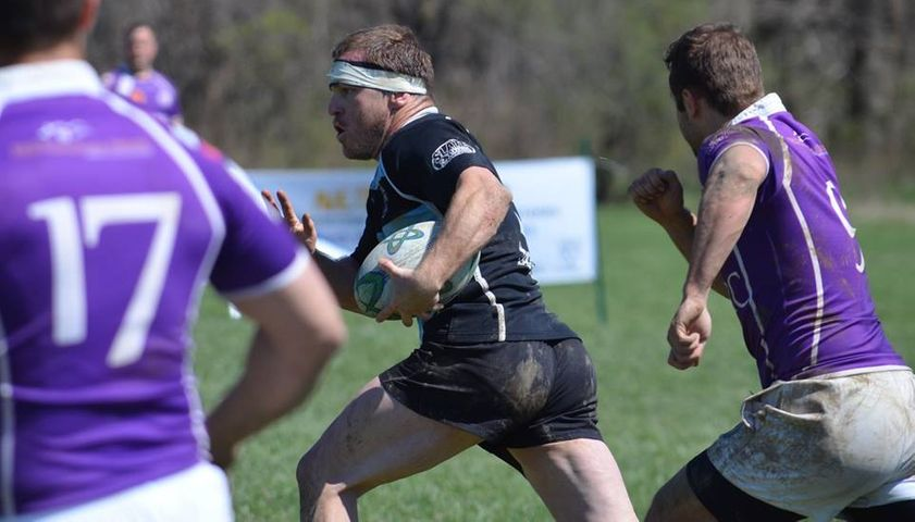 Columbia Outlaws Captain, Shan Schauffler, runs the ball in a rugby match.