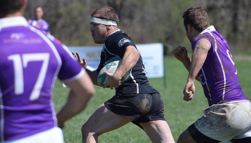 Columbia Outlaws Captain, Shan Schauffler, runs the ball in a rugby match.