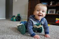 Story image: Previously immobile local toddler races off in the next family-created device