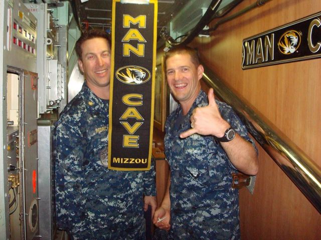 Submariners and sailors aboard the USS Columbia showing off their Mizzou gear