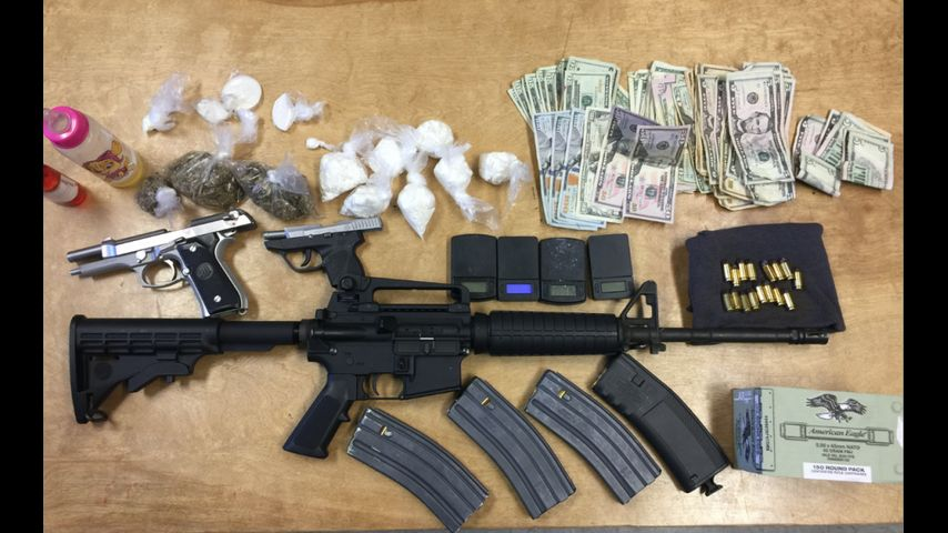 Agents find drugs, weapons in home next to elementary school
