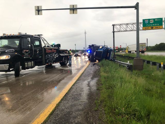 VIDEO: Wind blows tractor-trailer off Highway 54 overpass