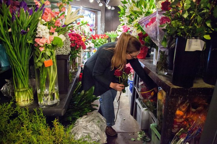 Ruth LaHue fetches freshly cut flowers from the cold storage room in My Secret Garden on Sunday, Feb. 12, 2017, in Columbia, Missouri. LaHue said she believes emotion can be better communicated if the customer directly talks to the designer.