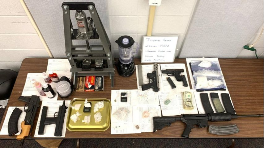 Three arrested after drugs, guns found during investigation