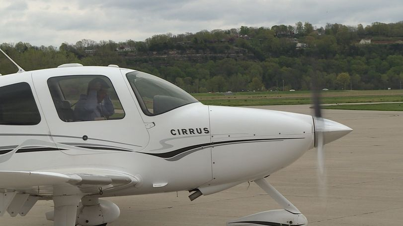 State Treasurer Scott Fitzpatrick puts on his headset before departing the Jefferson City Municipal Airport.