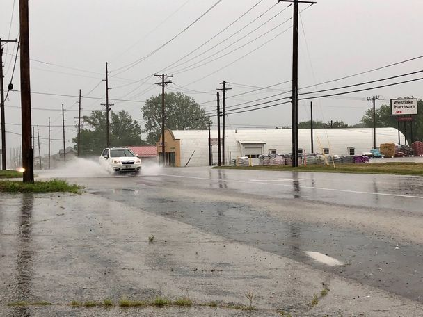 Water covers road near Paris Road and Business Loop 70 in Columbia.