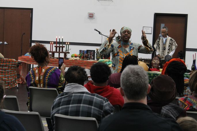During Kwanzaa, people often tell traditional tribe stories from Africa to bring celebrators closer to their heritage