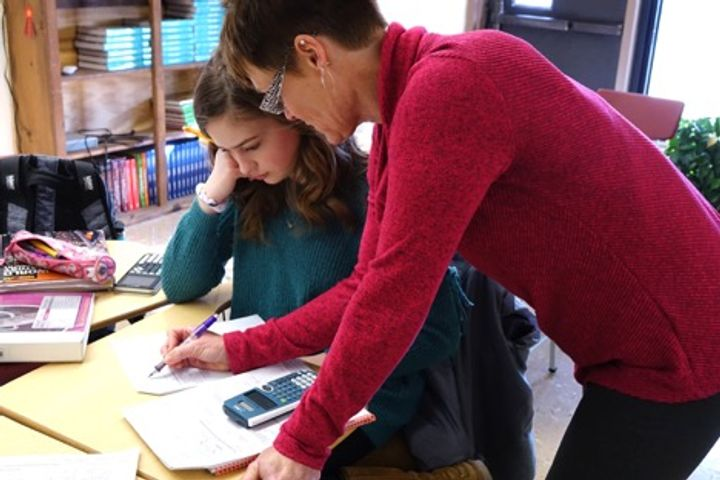 "South Shelby High School teacher Angela Resa works after hours with freshman Jarrah Wilt Monday, Feb. 12, 2018 in Shelbina, Missouri. Resa retired at the end of the 2016-17 school year, but returned in August 2017 when her position could not be filled. ""I've never been a stay-at-home person,"" Resa said. ""So, I had to find something to do anyways. It's a great thing to help kids to learn and share that joy of learning with them. It was an easy decision."""