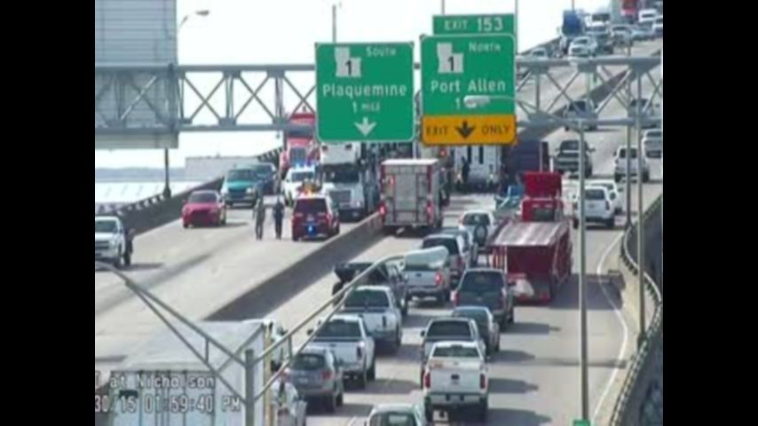 With police escort, first cars cross bridge 6 hours after crash