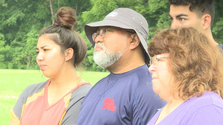 BOONVILLE - Residents listen to the stories shared by speakers at the unity at the park event on Saturday.