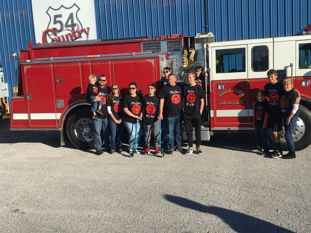 North Callaway Fire Protection District firefighter Tim Hays' family stand in front of his firetruck during a fundraiser on Sunday October 27.