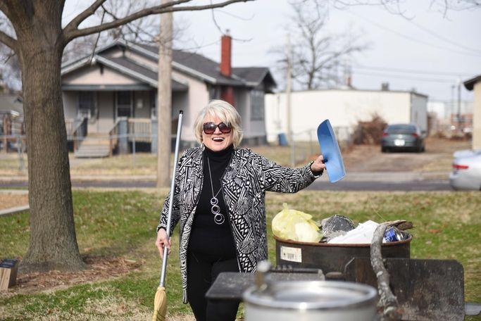 Judy Hubbard sweeps Downtown Optimist Park on Sunday, Dec 8, 2019. After attending church that morning, Hubbard joined Glenn Cobbins, who was her work partner prior to getting fired, to clean trash up in a local neighborhood. / Alexandria Wells