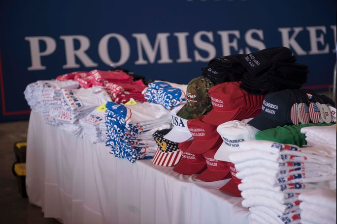 Lots of t-shirts and other merchandise for sale echo one of the president's mantras: