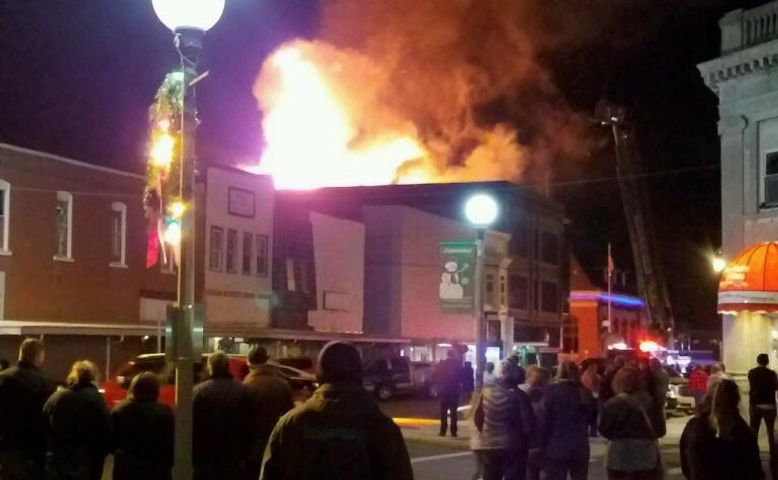 Bystanders in downtown Kirksville watch as the city's Arts Center erupts in flames Friday night. (Photo provided by Colton Hart)