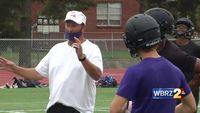 Norman Joseph coaching football at Catholic with former protege Gabe Fertitta