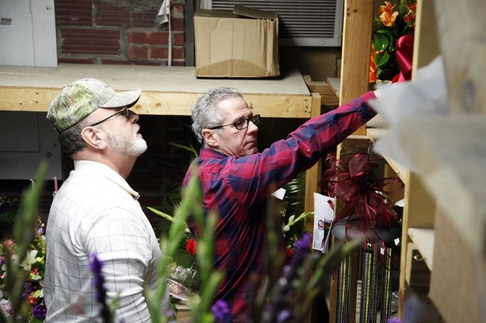 """Mike Moscato, owner of River City Florist, right, and Darrell Smith, a delivery driver, left, looks at the flowers ready to be delivered in River City Florist in Jefferson City, Missouri on Thursday, Feb. 9, 2017. Moscato is a member of Florists' Transworld Delivery (FTD), a floral wire service. """"It really is becoming less and less necessary for me to be a member,"""" Moscato said."""